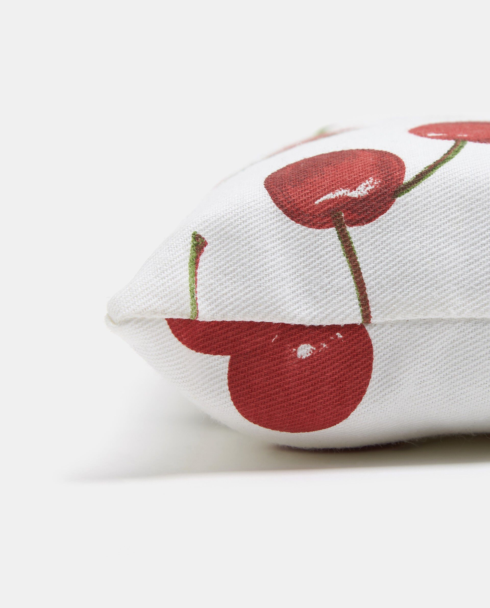 Cuscino con laccetti stampa ciliege